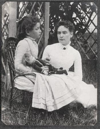 This 1888 photo released by the New England Historic Genealogical Society in Boston shows Helen Keller when she was eight years old, left, holding hands with her teacher, Anne Sullivan, during a summer vacation to Brewster, Mass., on Cape Cod. A staff member at the society discovered the photograph in a large photography collection recently donated to the society. When Sullivan arrived at the Keller household to teach Helen, she gave her a doll as a present. Although Keller had many dolls throughout her childhood, this is believed to be the first known photograph of Helen Keller with one of her dolls.  (AP Photo/Courtesy of the Thaxter P. Spencer Collection, R. Stanton Avery Special Collections, New England Historic Genealogical Society-Boston)